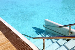 Steps that descend into the swimming pool. Steps that descend into a clear and quiet swimming pool Royalty Free Stock Image
