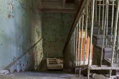 Steps in the destroyed building. Hull of an abandoned sanatorium slowly falling apart . On the stairs you can still walk, but it is not safe . In on a sunny day Royalty Free Stock Images