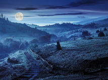 Steps down to village in foggy mountains at night Royalty Free Stock Photography