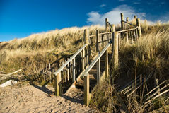 Steps on dunes on Troon beach. Damaged steps on protected sand dunes on beach in Troon, Ayrshire, Scotland, UK Stock Photography