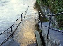 Steps into flood Stock Images