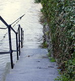Steps into flood Stock Photo