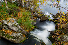 Steps of flowing river. River flowing downwards from between rocks Stock Images