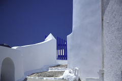 Steps and gate. Steps leading up to a blue gate Santorini Greece Stock Photography