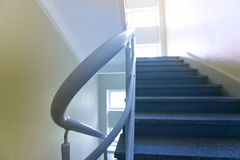 Steps and a handrail. Interfloor ladder in office building stock photo