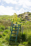 Steps and handrail over a ditch for walkers Royalty Free Stock Images