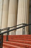 Steps And Handrails Next To Columns. Steps and handrails next to a row of columns Royalty Free Stock Image