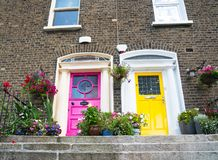 Steps lead to colorful terrace houses exterior two doors. Of different colors Stock Image