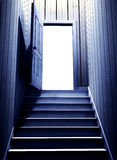 Steps leading from a dark basement to open the door Royalty Free Stock Photo