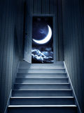 Steps leading from a dark basement to open the door Royalty Free Stock Image
