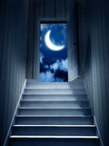 Steps leading from a dark basement to open the door Stock Photos