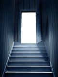 Steps leading from a dark basement to open the door Stock Photography