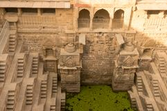 Steps leading down to the green water in abhaneri rajasthan