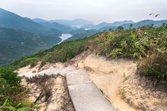 Steps leading down to Tai Tam Reservoir, Hong Kong Island Royalty Free Stock Photography