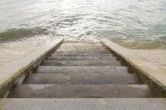Steps leading into sea. Exterior staircase leasing down and into the sea Stock Photo