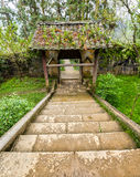 Steps leading to the ancient gate ancient beautiful architecture moss Royalty Free Stock Photo