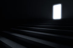 Steps leading to light. In the darkness Royalty Free Stock Image