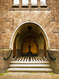 Steps leading to an old arched double door Royalty Free Stock Photos