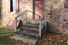 The steps leading to the old stone farmhouse. This stone farmhouse was built in the 18th century. The steps are a recent upgrade to the property Stock Image