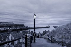 199 steps leading from Whitby Abbey to the harbour entrance, Yor stock images