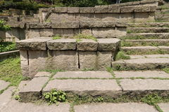 Steps. The steps are made up with many stones,and many grasses are growing on it Stock Images