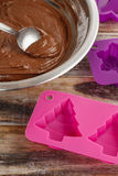 Steps of making chocolate cake: filling silicone mold with pastr Royalty Free Stock Photo