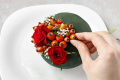 Steps of making decorative ball with rose hip, hawthorn and rowa Royalty Free Stock Photo
