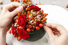 Steps of making decorative ball with rose hip, hawthorn and rowa Royalty Free Stock Image