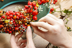 Steps of making door wreath with rose hip, hawthorn and rowan be stock photos