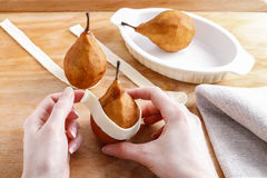 Steps of making pear in pastry - delicious dessert. Stock Image