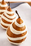 Steps of making pear in pastry - delicious dessert. Royalty Free Stock Image