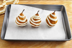 Steps of making pear in pastry Royalty Free Stock Photography