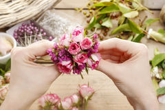 Steps of making wrist corsage. Florist at work. Royalty Free Stock Photo