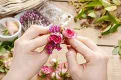 Steps of making wrist corsage. Florist at work. Stock Images