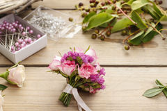 Steps of making wrist corsage. Florist at work. Stock Image