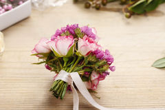 Steps of making wrist corsage. Florist at work. Royalty Free Stock Photography