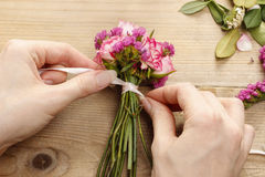 Steps of making wrist corsage. Florist at work. Royalty Free Stock Images