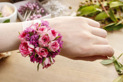 Steps of making wrist corsage. Florist at work. Stock Photos