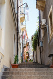 Steps on narrow street in Catania city, Sicily Stock Images