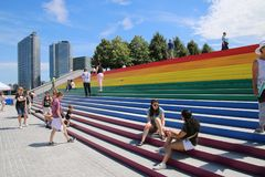 Giant Pride Flag. The steps of a New York City transformed from gray granite to the city`s largest pride flag made of rainbow vinyl stock photography