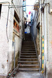Steps through old narrow alley. Steps leading through an old narrow back alley with dilapidated buildings close on two sides.  Taken in the older part of a town Royalty Free Stock Photo