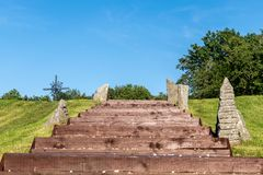 Steps outside, leading to a christian cross. royalty free stock photography