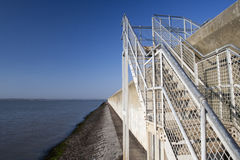 Steps over the sea wall on Canvey Island, Essex, England Stock Photography