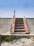 Steps over seawall in Wales UK. Steps over seawall or sea defense Borth North Wales United Kingdom Stock Photos