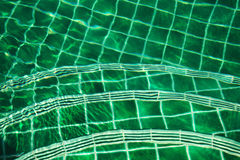 Steps into the pool from the mosaic in green. Stock Photography