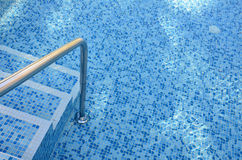 Steps into the pool. Stock Image