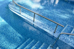 Steps into the pool. Royalty Free Stock Image