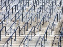 Steps and rails, rhythm in photography. Stone steps and metal rails, the concept of rhythm in photography Stock Images