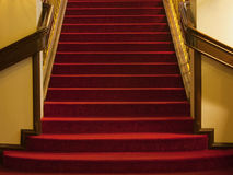 Steps with red carpet. A flight of red steps from an old mansion that has been converted into a hotel. It also could be read as a theater or an opera house Royalty Free Stock Photography