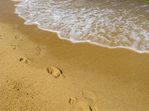 Steps on the sand and wave Royalty Free Stock Photo